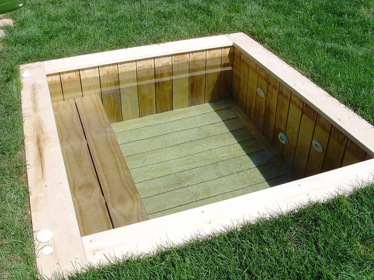 Piscine bois carr e enterr e et sur mesure natura piscines for Rechauffeur petite piscine