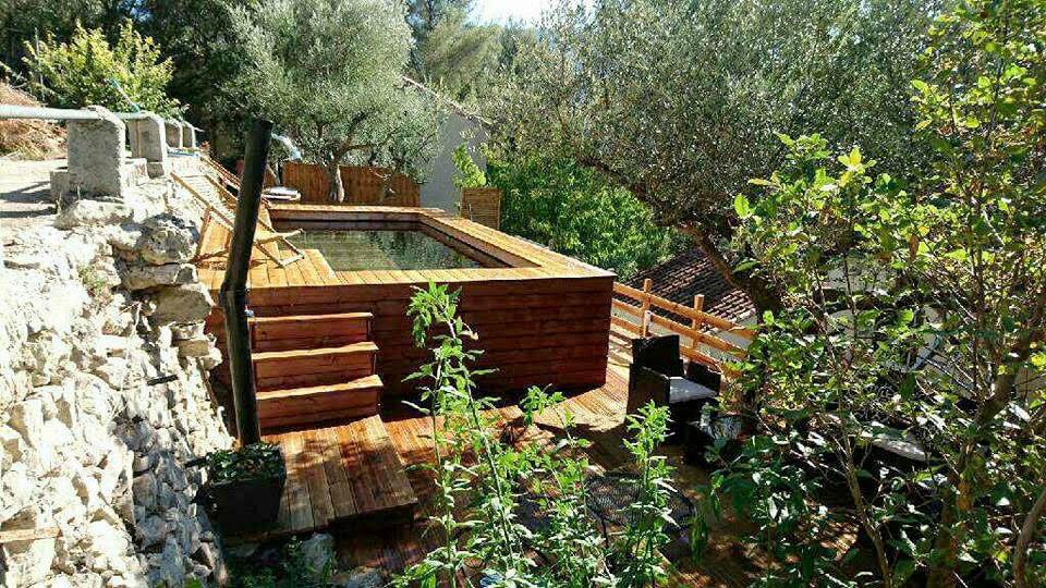 Piscine hors sol en bois sur mesure haut de gamme natura for Installateur de piscine en bois
